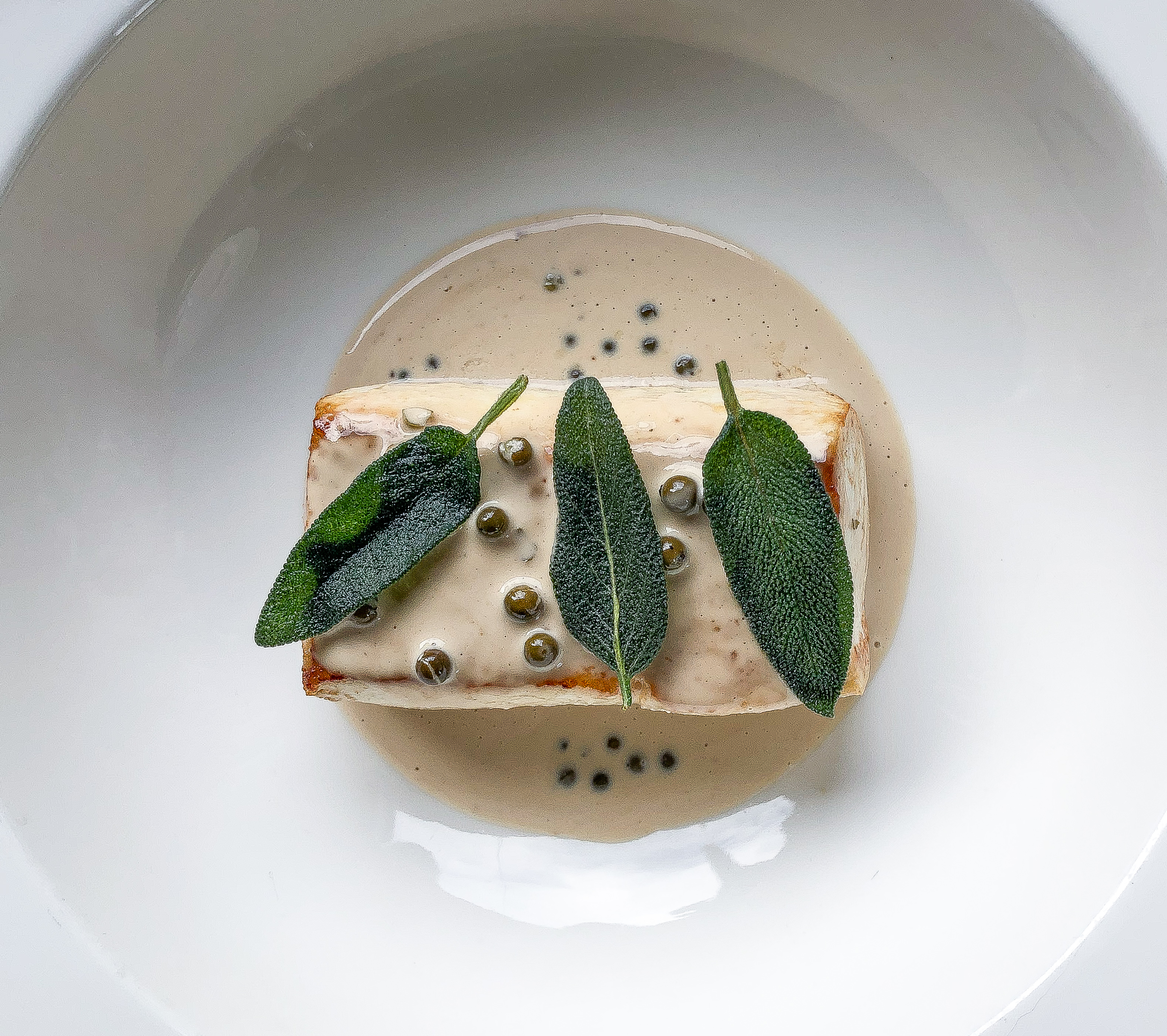 Halibut with Green Peppercorn Sauce and Sage